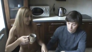 Stud is pounding lawful age teenager's vagina wildly at the kitchen ship aboard